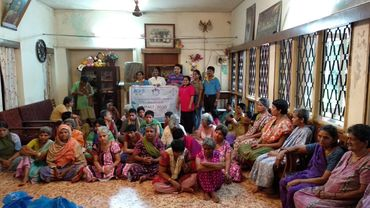 Distribution of cloths to white doves